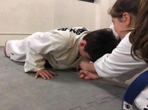 Children developing strength through Martial Arts